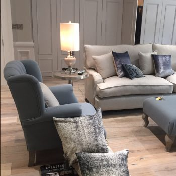 Blue linen chair with cream linen sofa