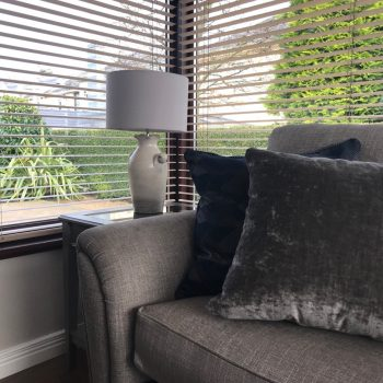 Grey linen sofa with navy and charcoal scatter cushions